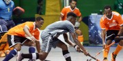 Shakeem Fausette (on the ball) in action for Saints Hockey Club against GCC
