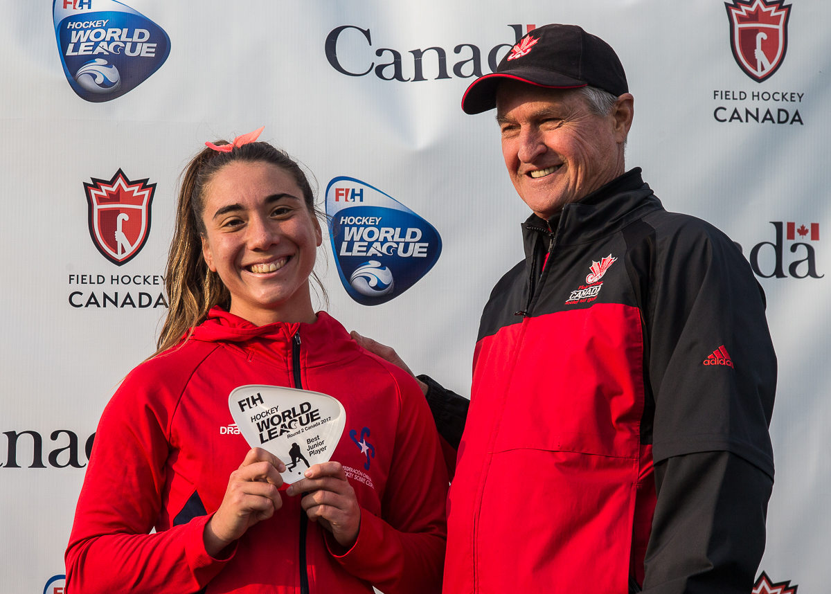 Ian Baggott, Field Hockey Canada President and long-time West Vancouver FHC Member, gives the Best Junior Player Award to Denise Krimerman (CHI)