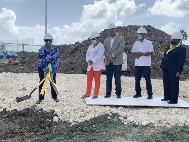 Sandra Osborne (left), President of the Barbados Olympic Association (BOA), breaking the ground for the construction as Jacqueline Gill, Executive Officer of the Tourism Development Corporation (TDC); Mark St. Hill, President of the Barbados Hockey Federation (BHF); Sir Austin Sealy, IOC member; and Yolande Howard, Permanent Secretary in the Ministry of Sports, look on.